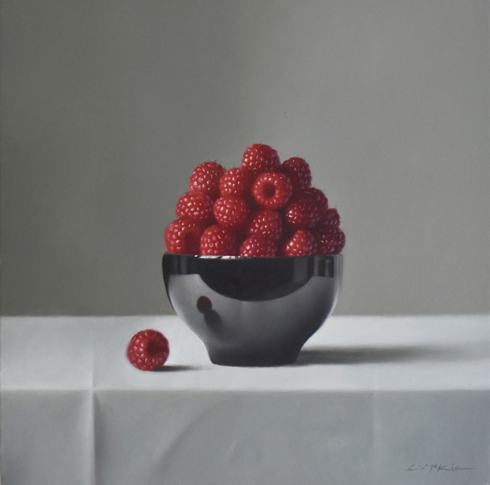 Raspberries in Black Bowl
